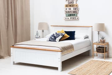 White wooden bed frame with oak effect trims